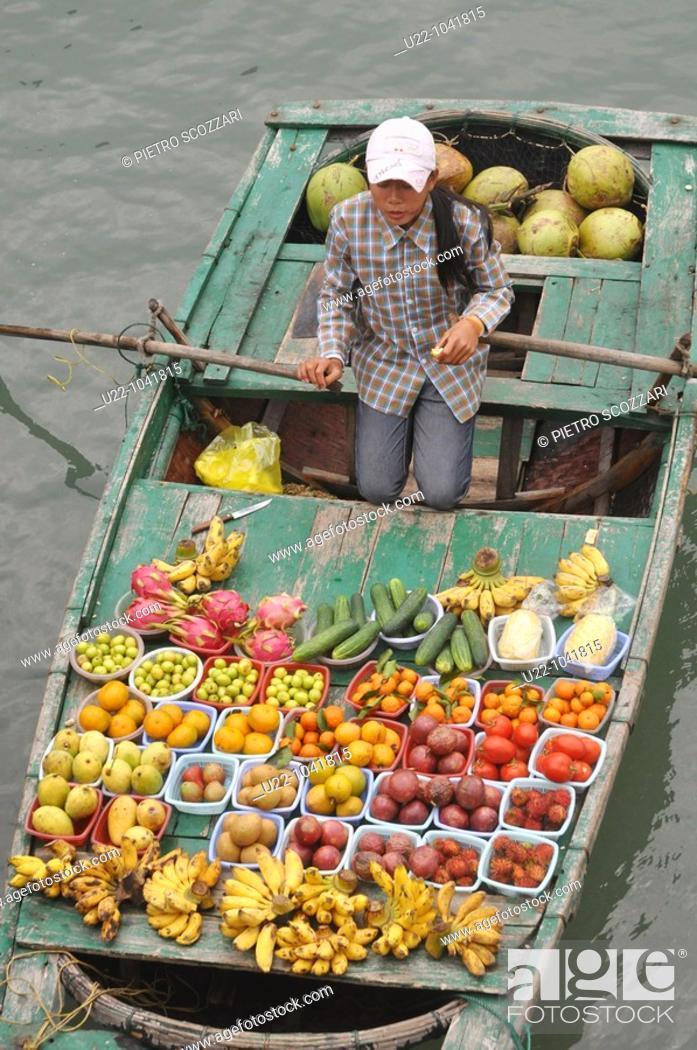 Stock Photo: Halong Bay (Vietnam): a fruit seller on her boat.