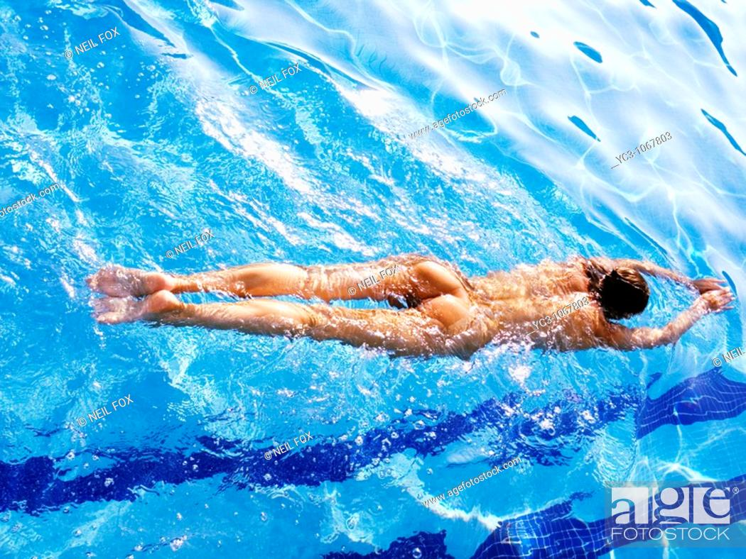 Stock Photo: Naked swimmer in swimming pool.