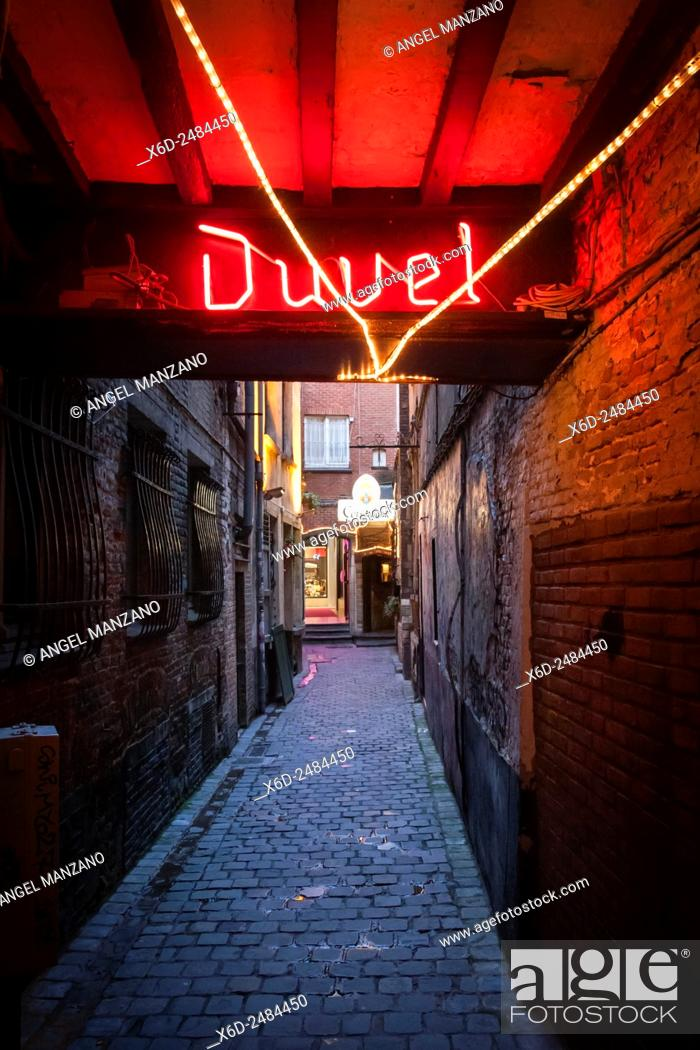Stock Photo: Duvel beer sign in passage in Brussels old town.