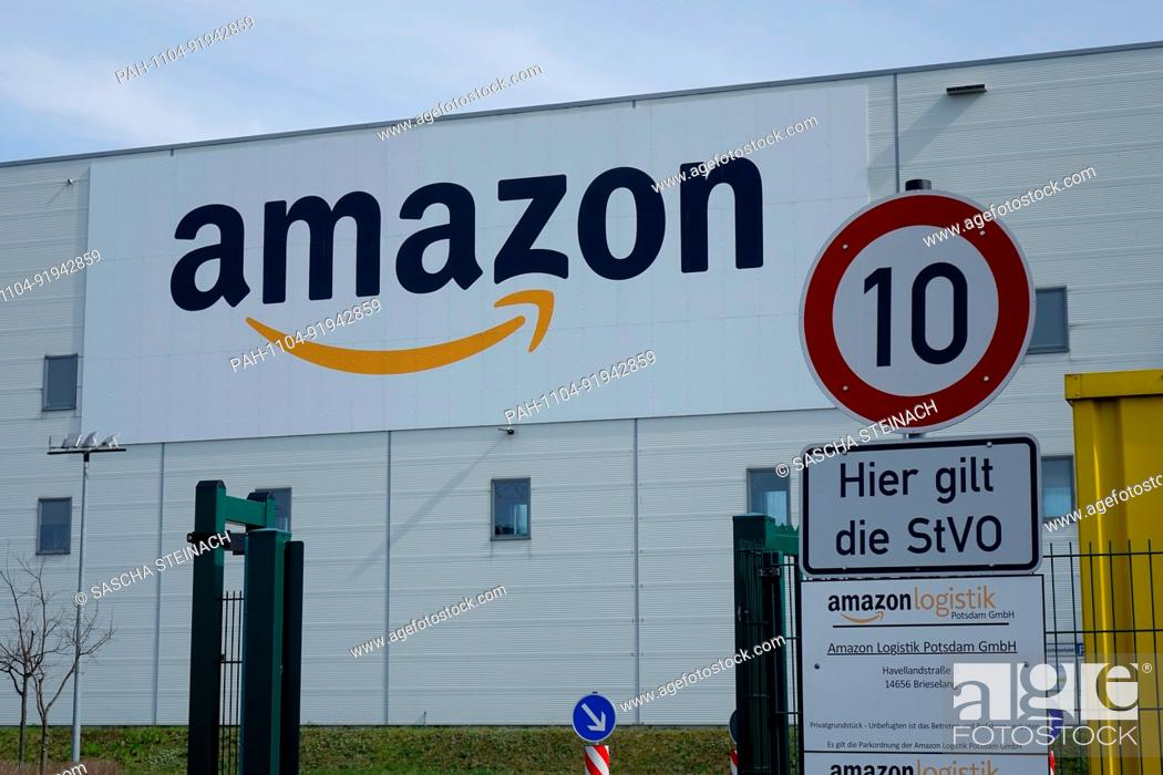 1eb96972fbd Stock Photo - View of the amazon logo behind the entrance a logistics centre  of US-American online retailer Amazon in Brieselang