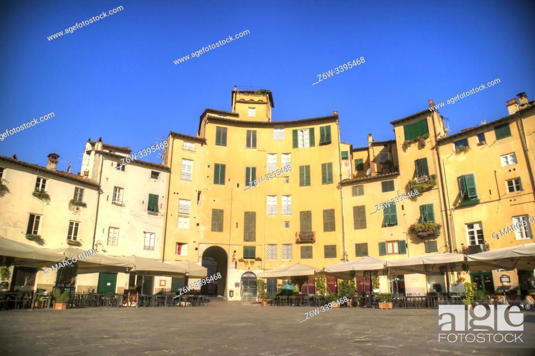 Stock Photo: The characteristic buildings of the Piazza dell'Anfiteatro in Lucca, Italy.