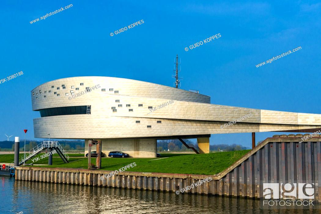 Stock Photo: Nijmegen, Netherlands. Architectureal designed head quarters and office building onside Nijmegen's inland harbor container terminal during a sunny.