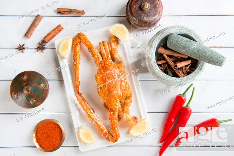 Stock Photo: Top view cooked delicious hot and spicy sauce blue crab and ingredients, on wood background. Fresh cook with hot smoke steams.