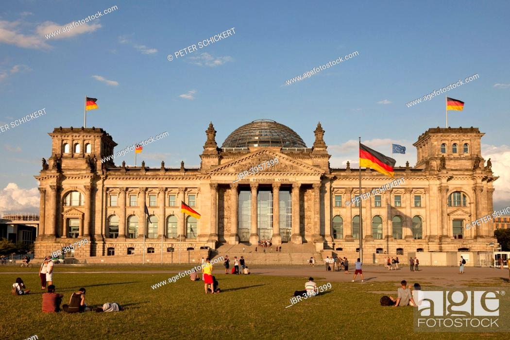 Reichstag and German flags, Berlin, Germany, Stock Photo