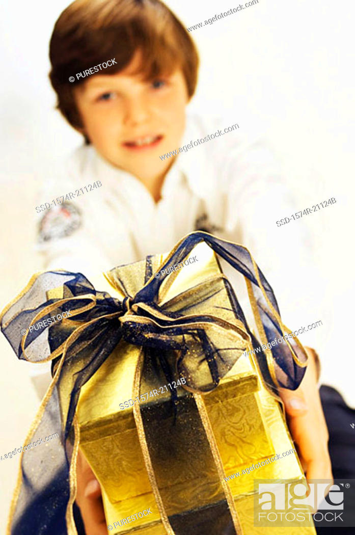 Stock Photo: Portrait of a boy holding two Christmas presents.