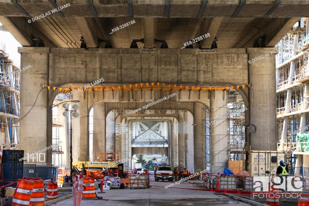 Stock Photo: Construction under the Granville Street Bridge on Vancouver House, a new tower in downtown Vancouver, BC, Canada, designed by BIG.