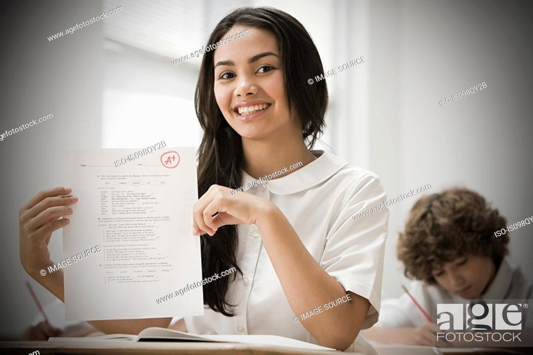 Stock Photo: Girl with exam paper.