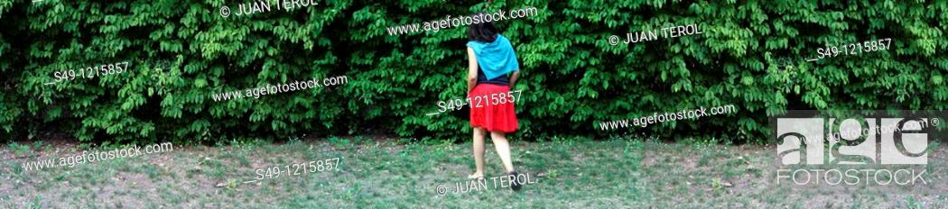 Stock Photo: woman running in a garden.