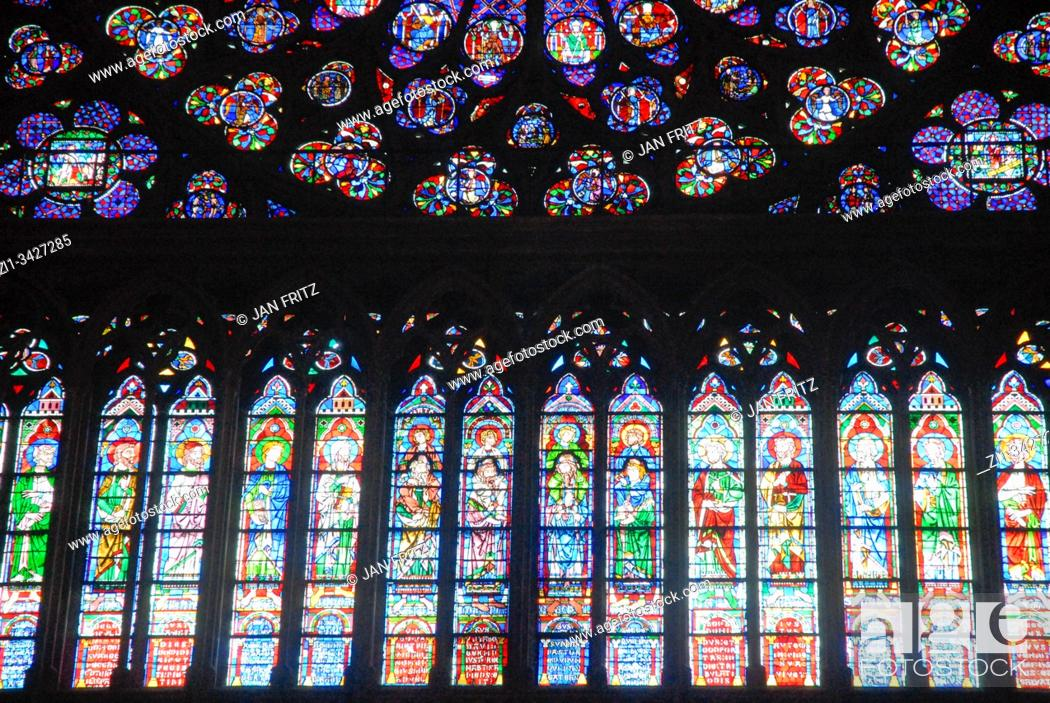 Stock Photo: colourful stained windows in Notre Dame of Paris, France.