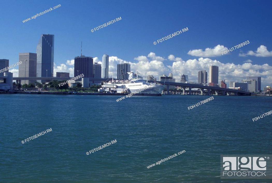Stock Photo: Miami, FL, Florida, Atlantic Ocean, Cruise ship docked at the Port of Miami Biscayne Bay with a view of the downtown skyline of Miami.