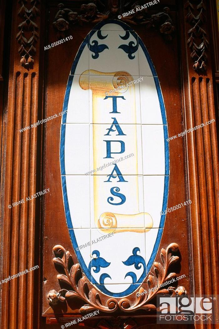 Stock Photo: Spain - Madrid - Tapas bar - old - ceramic tiles in wooden frame - notice.