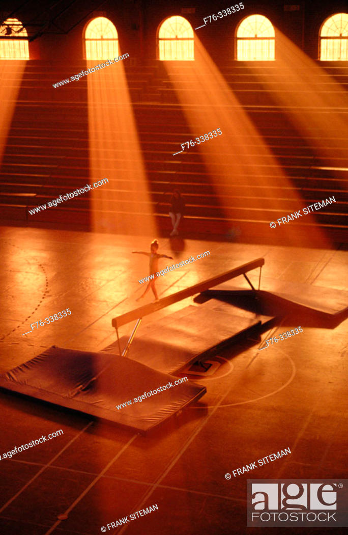 Stock Photo: Young girl practicing on balance beam.