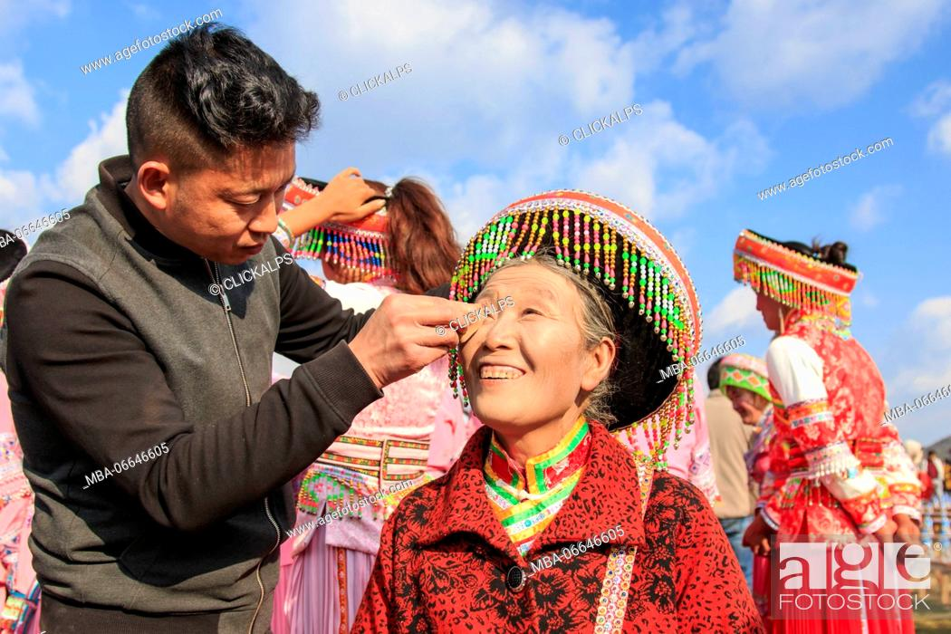 Stock Photo: Chinese woman in traditional Miao attire during the Heqing Qifeng Pear Flower festival, China.