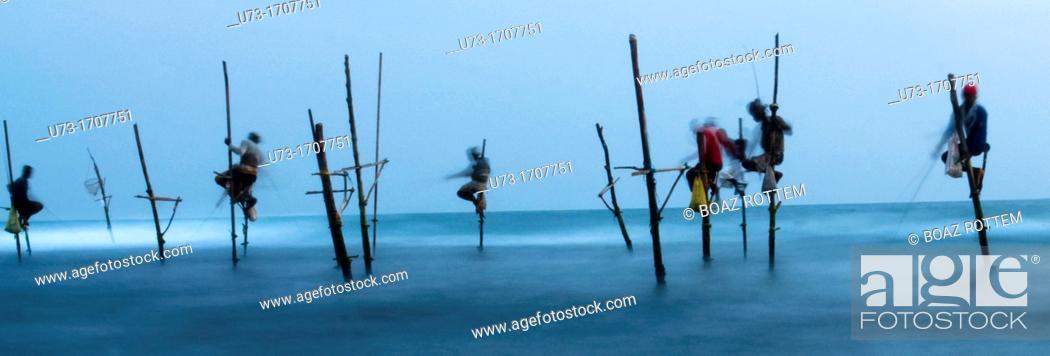 Stock Photo: Fishermen perched on their stilts in Midigama, Sri Lanka.