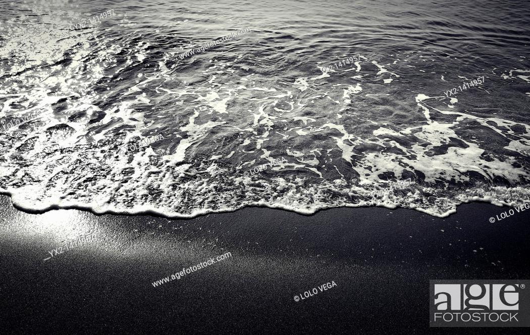 Stock Photo: Small wave on the beach, Mataro, Catalonia, Spain.
