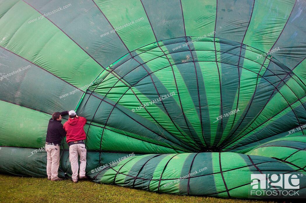 Stock Photo: Hot air balloon preparing for flight over Garrotxa Natural Park,Girona province  Catalonia  Spain.