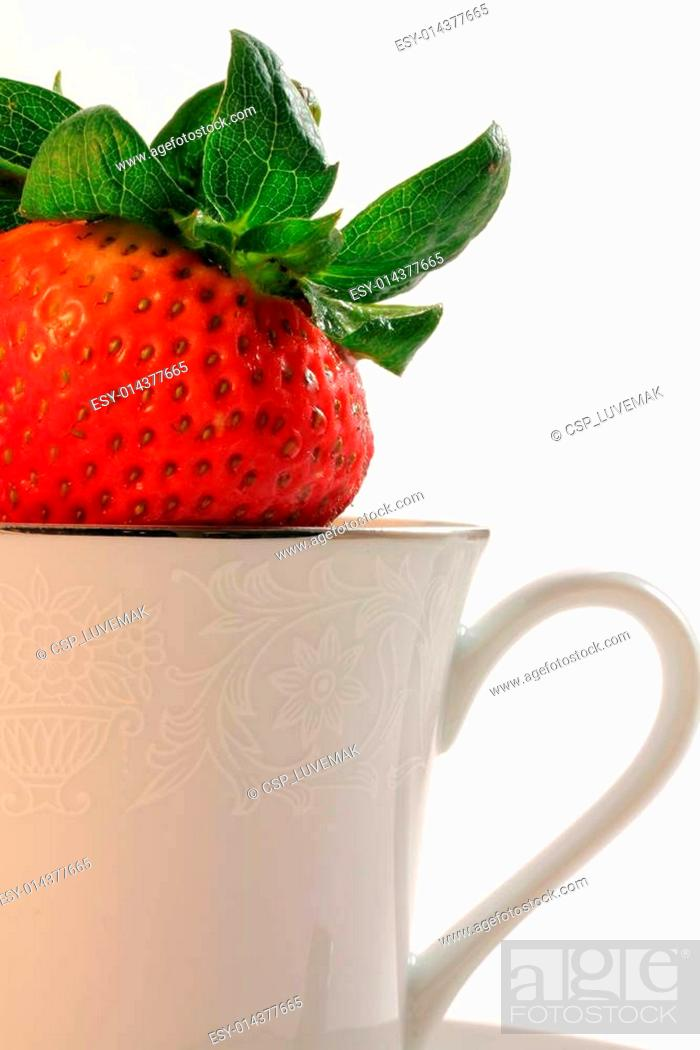 Stock Photo: Fresh Red Strawberries inside a White China Teacup.