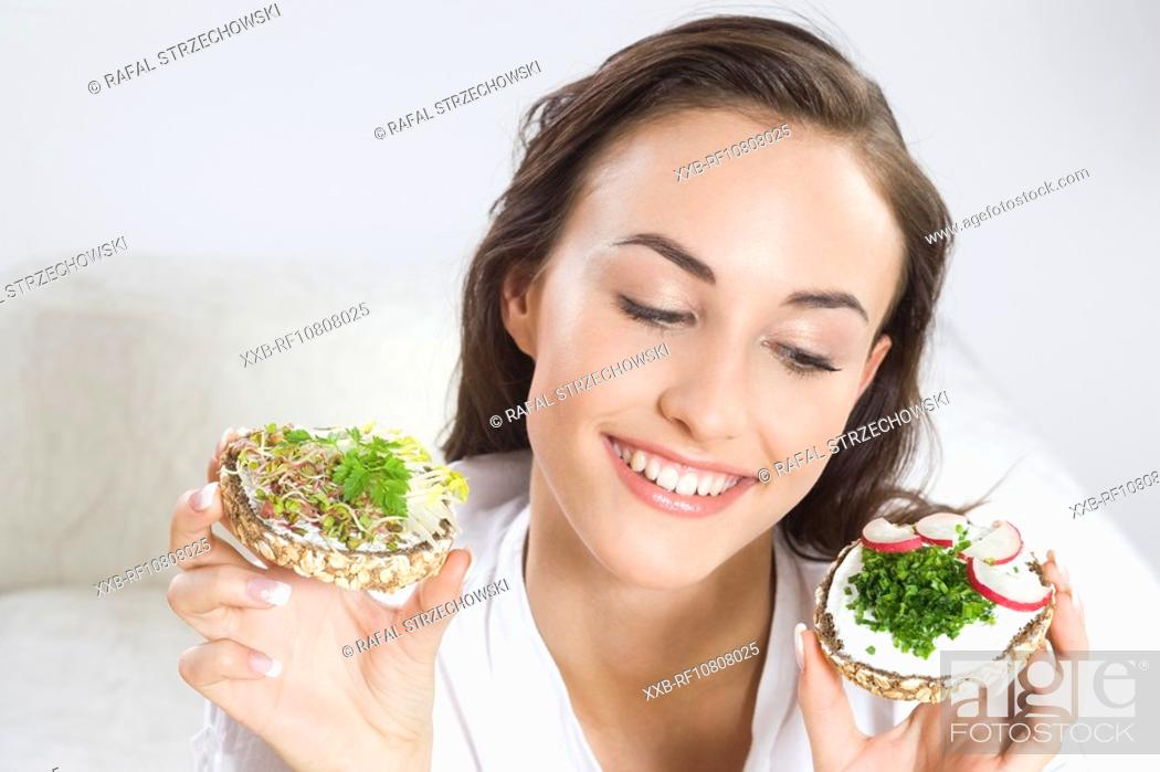 Stock Photo: Young woman with sandwiches.