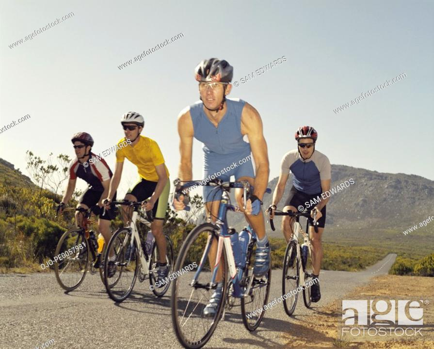 Stock Photo: Four bikers on a country road.
