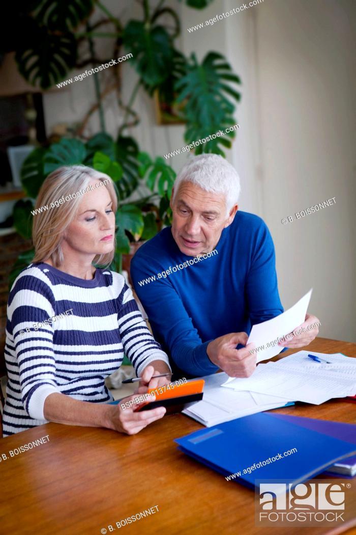 Stock Photo: Couple doing paperwork.