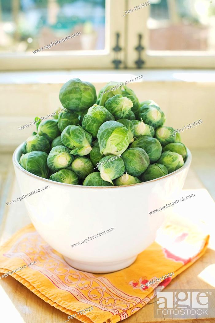 Stock Photo: Bowl Full of Brussels Sprouts by Sunlit Window.
