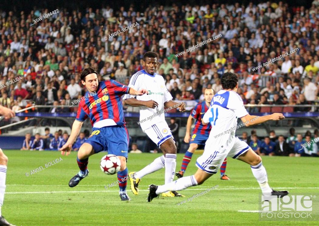 Stock Photo: Barcelona, Camp Nou Stadium, 29/09/2009, UEFA Champions League, FC Barcelona vs. FC Dynamo Kyiv, Leo Messi and Ayila Yussuf.