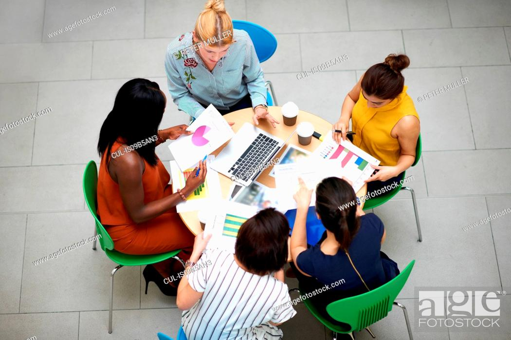 Stock Photo: High angle view of business women sitting at table in meeting.