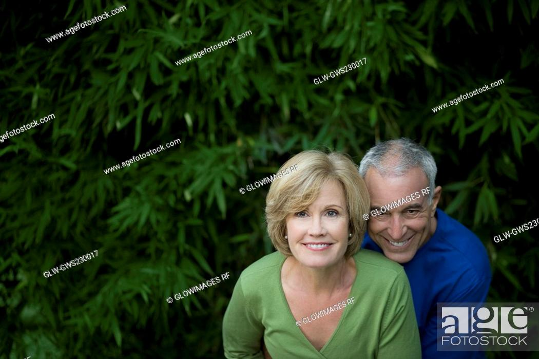Stock Photo: Portrait of a senior man with a mature woman smiling together.