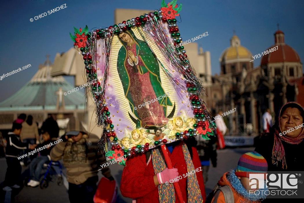Stock Photo: A pilgrim carries an image of the Our Lady of Guadalupe outside of the Our Lady of Guadalupe Basilica in Mexico City, December 9, 2012.