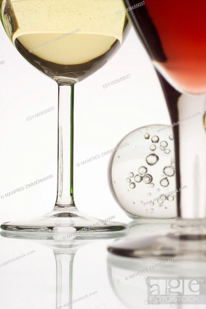 Stock Photo: Detail of a glass of red wine and a glass of white wine.