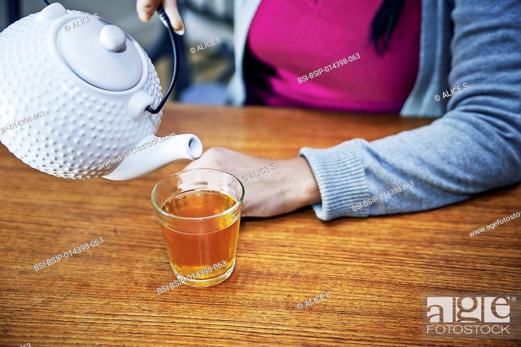 Stock Photo: Woman pouring tea.