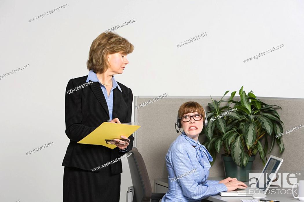 Stock Photo: Businesswoman watching over work.