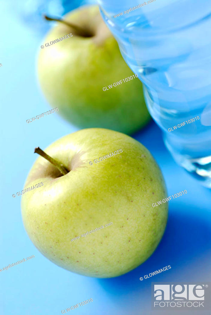 Stock Photo: Close-up of two apples and a water bottle.