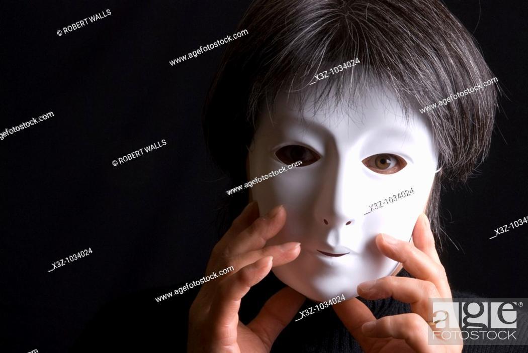 Stock Photo: Woman wearing a plain white mask.