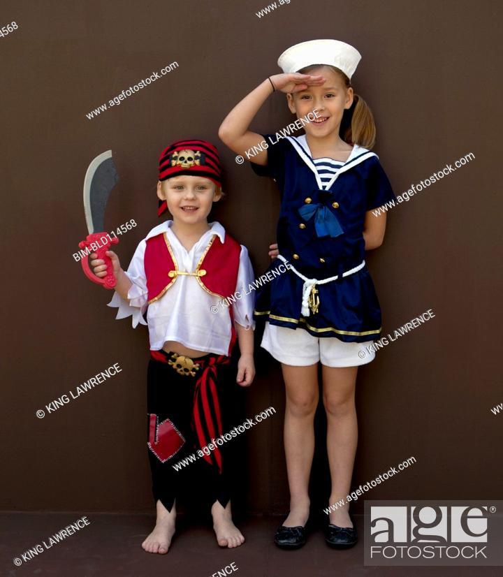 Stock Photo: Caucasian children playing dress up.