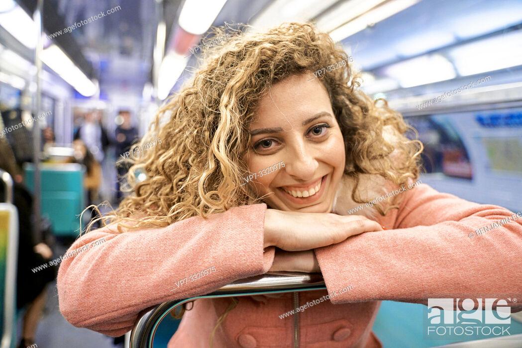 Stock Photo: woman in public transport metro train, in Paris, France.