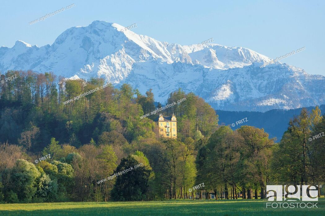 Stock Photo: Park of Hellbrunn Castle with Monatsschloessl and Alps, Salzburg, Austria.