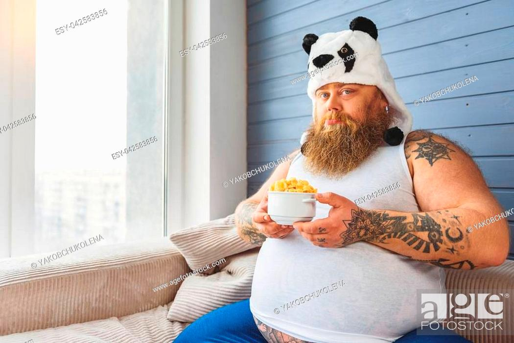 This Healthy Food Is Not For Me Sad Fat Man Is Holding Bowl Of Cereals And Looking At Camera With Stock Photo Picture And Low Budget Royalty Free Image Pic Esy 042583856