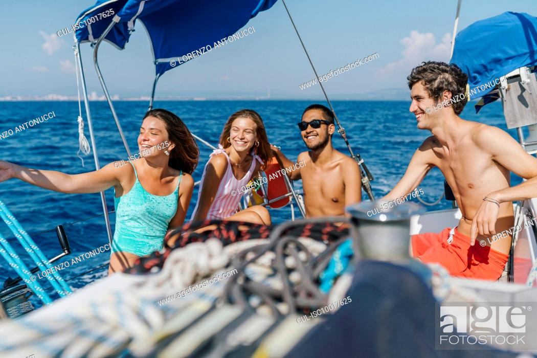 Stock Photo: Friends on sailing holiday, Italy.