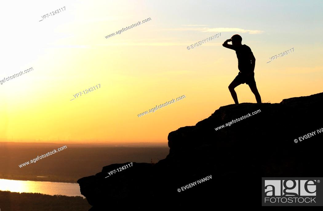 Stock Photo: Man observes Volga river from the highest point of Zhiguli mountains in Russian National Park 'Samara Luka'.