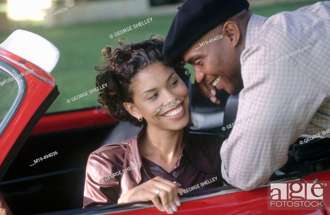 Stock Photo: flirting with a girl in a car.