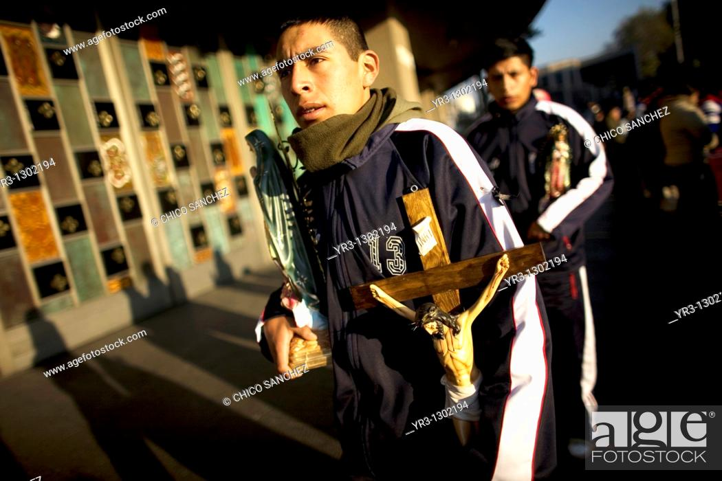 Stock Photo: A pilgrim hold a cross outside the Our Lady of Guadalupe Basilica in Mexico City, December 7, 2010  Hundreds of thousands of Mexican pilgrims converged on the.