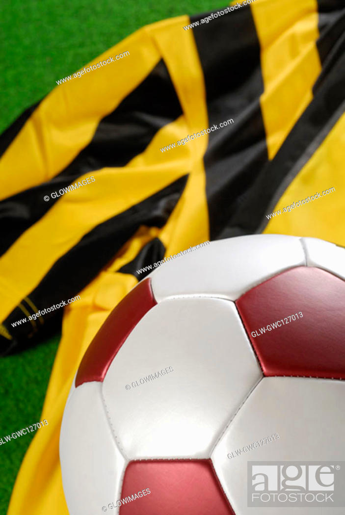 Stock Photo: Close-up of a soccer ball on a soccer uniform.