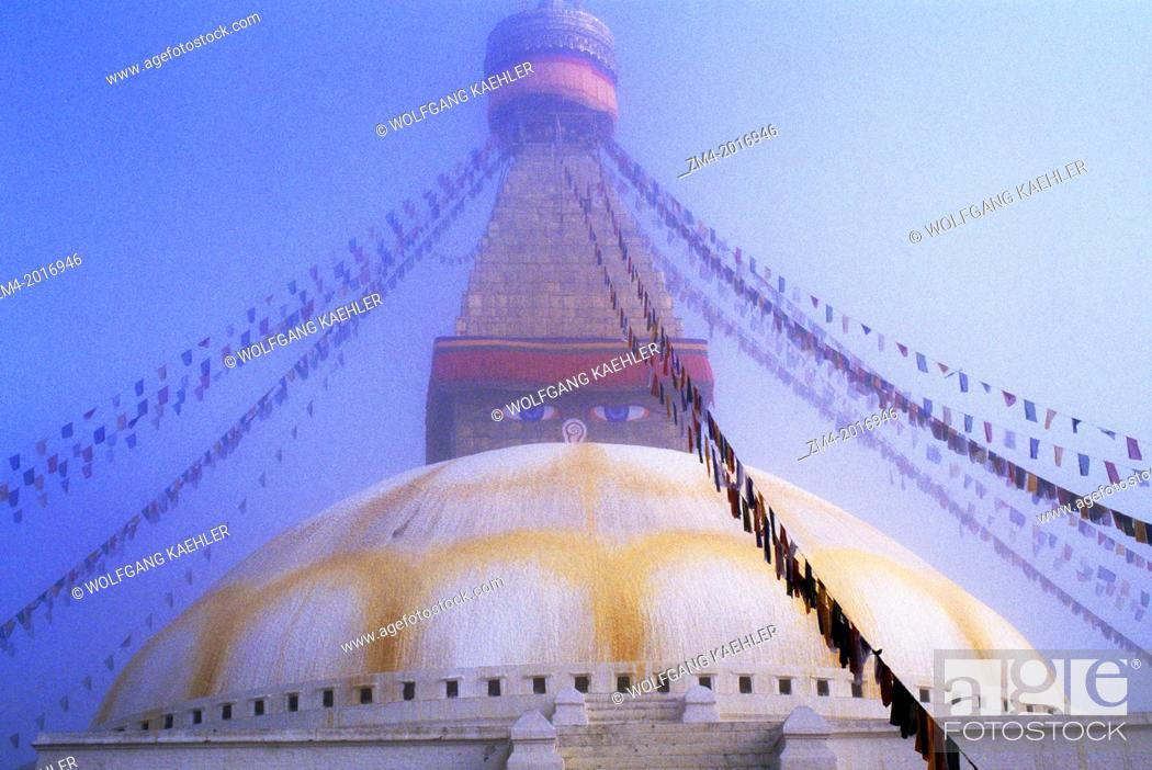 Stock Photo: NEPAL, KATHMANDU, BOUDHNATH, TIBETAN STUPA (TEMPLE) IN FOG, PRAYER FLAGS.