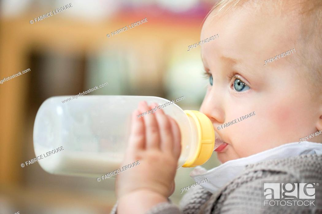 Stock Photo: Close-up of a baby girl feeding milk.