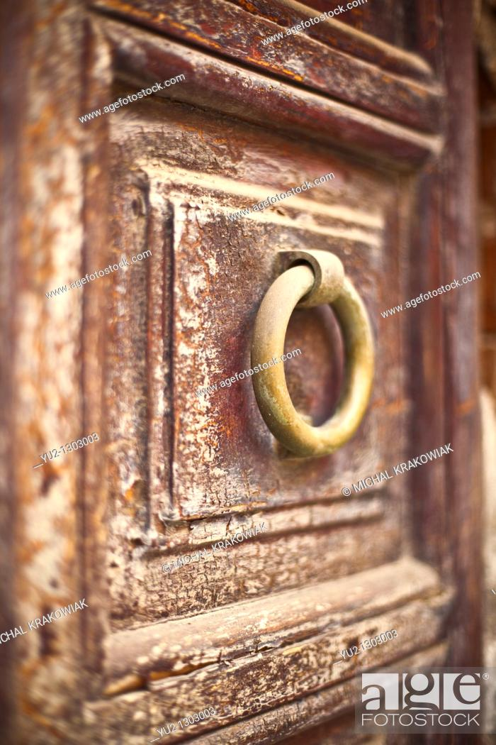 Stock Photo: Knocker on old wooden door  Photo taken on Sardinia, Italy  Very shallow depth of field.