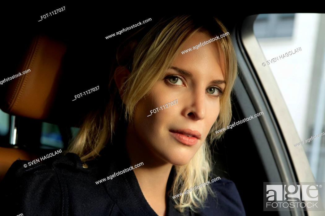 Stock Photo: Portrait of woman in car.
