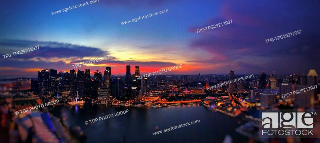 Imagen: High angle view of the city at night through hotel Marina Bay Sands; Singapore.