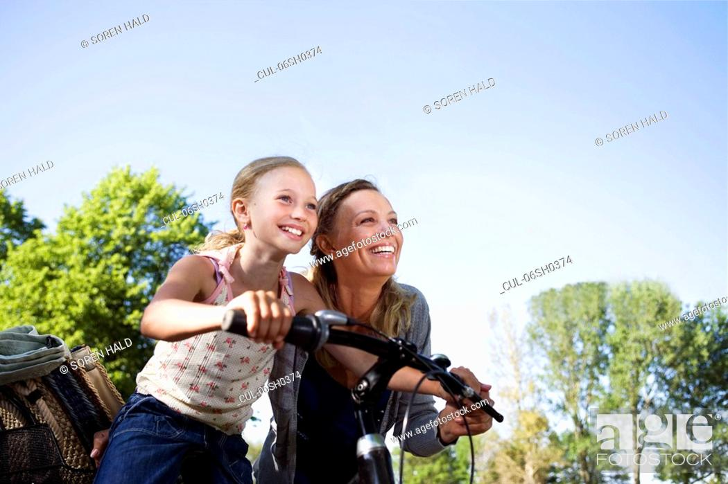 Stock Photo: Mother and daughter with bike.