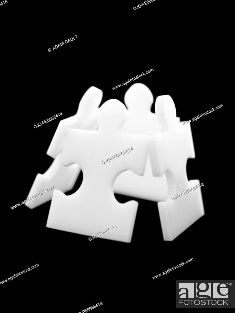 Stock Photo: Four puzzle pieces leaning in box formation.